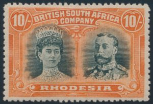 Lot 1973 Rhodesia #117 1910 10sh red orange and brown green Queen Mary and King George V