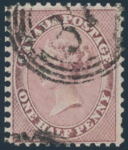 Lot 29, Canada 1858 half pence rose Queen Victoria, XF used with 4-ring numeral