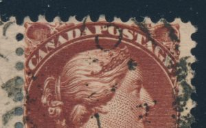 Enlargement of major re-entry from Lot 119, Canada 1890s six cent red brown Small Queen used pair